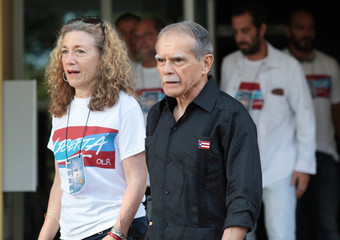 Puerto Rican Oscar Lopez Rivera walks after being released from house arrest in San Juan