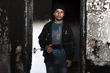 Businessman and rebel Wares poses for a portrait in Benghazi