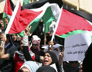 Jordanian Muslims shout anti-Israel slogans during a demonstration in Amman