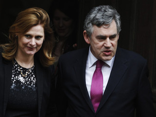 Britain's former Prime Minister Gordon Brown and wife Sarah leave the Leveson Inquiry at the High Court in London