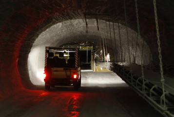 A vehicle drives along a tunnel in pilot mine which is being tested for potential use as a permanent nuclear waste storage facility in Gorleben