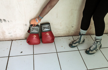 Aguirre picks up her boxing gloves after training at the National Institute of Sport in Managua