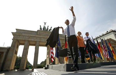 U.S. President Obama waves after speaking in front of the Brandenburg Gate in Berlin