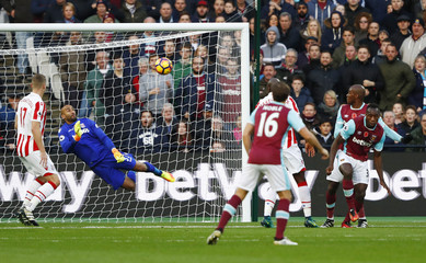 Stoke City's Lee Grant saves a shot from West Ham United's Angelo Ogbonna