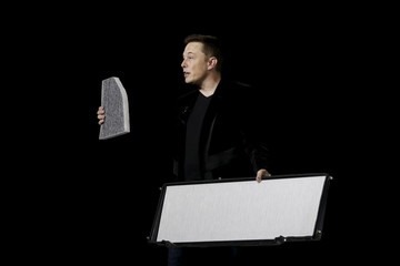Tesla Motors CEO Elon Musk delivers Model X electric sports-utility vehicles during a presentation in Fremont, California