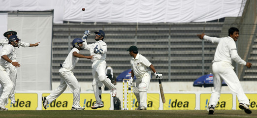 India's captain and wicketkeeper MS Dhoni catches a ball to dismiss Bangladesh's Mohammad Ashraful successfully in Dhaka