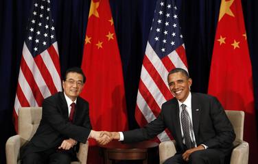 U.S. President Barack Obama and Chinese President Hu Jintao shake hands during the APEC Summit in Honolulu