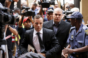 Oscar Pistorius arrives at the North Gauteng High Court in Pretoria, South Africa for a bail hearing