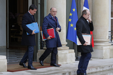 French Prime Minister Valls, Interior Minister Cazeneuve and Justice Minister Urvoas leave the weekly cabinet meeting at the Elysee Palace in Paris