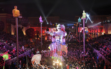 The Michelin King float makes it way through the crowd during the Carnival parade in Nice