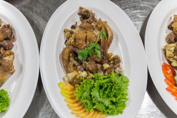Steam pork leg with vegetable food background