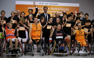Netherlands' PM Rutte poses with Tokyo governor Masuzoe, Suzuki, the head of Japan's sports agency, students and wheelchair basketball players of Japan and Netherlands, during a photo session at a wheelchair basketball demonstration event in Tokyo