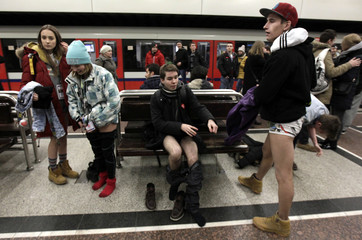"Passengers without their pants wait for a subway train during the ""No Pants Subway Ride"" event in Warsaw"