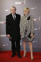 Claude Serillon, France's presidential communication advisor, and Catherine Ceylac pose as they arrive at the 38th Cesar Awards ceremony in Paris