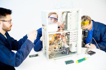 Technicians repairing computers