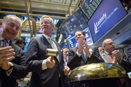 Easterly Government Properties, Inc. CEO Bill Trimble rings a ceremonial bell to celebrate his company's IPO on the floor of the New York Stock Exchange