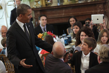 "U.S. President Obama greets Taddy Pettit, from Oakwood, at ""Kids' State Dinner"", in Washington"