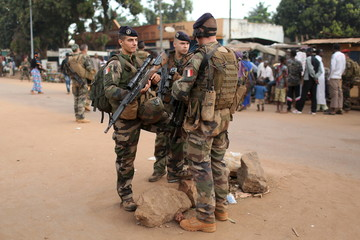 French peacekeeping soldiers patrol a street of the mostly Muslim neighbourhood of PK 5 in Bangui