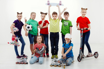 A group of children with sports facilities, isolated on a over white background