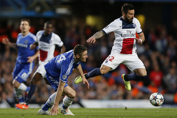 Chelsea's Cahill challenges Paris St Germain's Lavezzi during their Champions League quarter-final second leg soccer match at Stamford Bridge in London