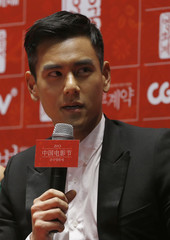"""Cast member Peng speaks during news conference to promote his movie """"A Wedding Invitation"""", the closing film of the Chinese Film Festival, in Seoul"""