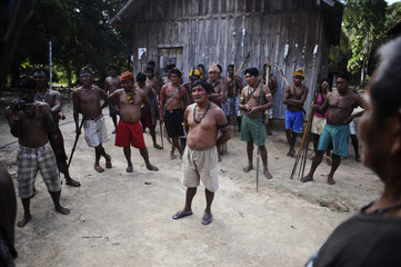 Munduruku Indian warriors hold a meeting while on their search for illegal gold mines and miners in western Para state