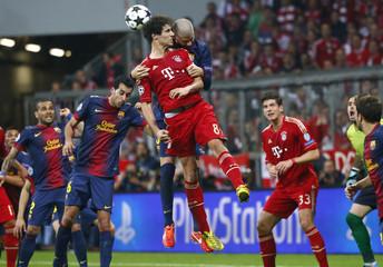 Barcelona's Pique jumps for header with Bayern Munich's Martinez during Champions League semi-final first leg soccer match in Munich
