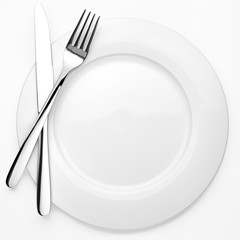 Empty plate, fork, knife, white background, isolated, top view from first person