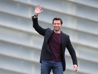 """Australian actor Hugh Jackman gestures to fans during a photocall to promote the film """"Prisoners"""", on the eighth day of the San Sebastian Film Festival"""