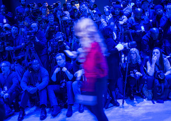 Members of the media wait for the Nicholas K Fall 2014 collection during New York Fashion Week