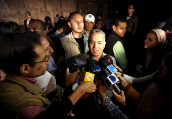 Egyptian Minister of Antiquities Mamdouh el-Damati speaks to members of the media after a presentation in front of the Great Pyramid of Giza (also known as the Pyramid of Khufu) on the outskirts of Cairo
