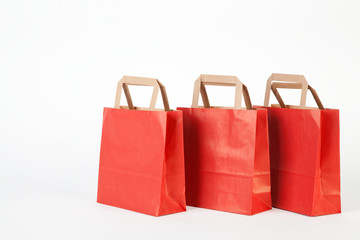 Three red shopping bags