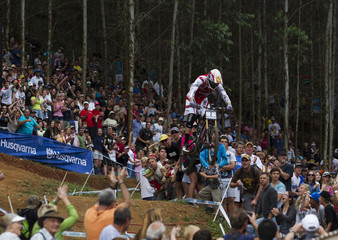 South Africa's Greg Minnaar heads toward the finish line to win the Men's Downhill during the UCI Mountain Bike World Cup in Pietermaritzburg