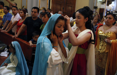 Catholic devotees prepare for the re-enactment of Holy Thursday procession at Iztapalapa neighbourhood in Mexico City