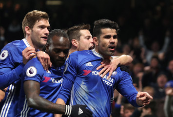 Chelsea's Diego Costa celebrates scoring their first goal with team mates