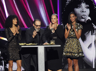 Relatives stand in for Donna Summer during her induction at the 2013 Rock and Roll Hall of Fame induction ceremony in Los Angeles