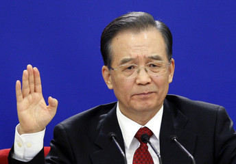 China's Premier Wen gestures during his annual news conference following the closing session of the NPC in Beijing