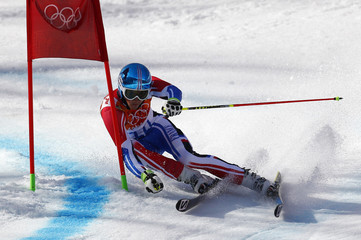 France's Missillier clears a gate during the second run of the men's alpine skiing giant slalom event at the 2014 Sochi Winter Olympics