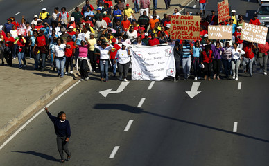 South African state workers seeking higher wages take part in a strike outside a hospital in Soweto