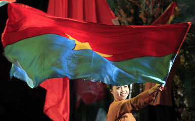 A performer waves a flag before the opening of the 8th Congress of the Vietnam Fatherland Front in Hanoi
