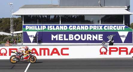 Honda MotoGP rider Marquez of Spain rides past the chequered flag to win the Australian Grand Prix on Phillip Island