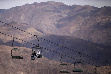 Tourists use a chairlift at the El Colorado ski centre at Los Andes Mountain range, near Santiago
