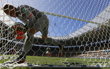 Goalkeeper Cillessen of the Netherlands retrieves the ball after conceding a goal to Mexico's Dos Santos during their 2014 World Cup round of 16 game at the Castelao arena in Fortaleza
