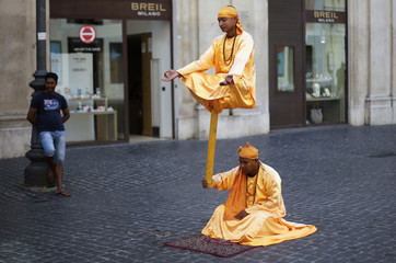 Street artists perform in downtown Rome