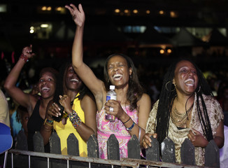 Spectators react to the music during the Jamaica Jazz and Blues 2013 festival in Trelawny