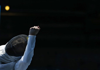 Italy's Valentina Vezzali reacts as she beats France's Astrid Guyart during their women's foil team semifinal fencing match at the London 2012 Olympic Games
