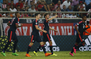 Players of Bayern Munich celebrate a goal against Olympiacos during their Champions League group F soccer match at the Karaiskakis stadium in Piraeus