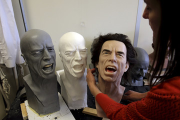 Helene Jonca, one of the painters of the Paris Grevin wax sculpture museum works on the head of Rolling Stones lead singer Mick Jagger in their workshop in Paris