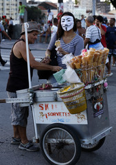 A demonstrator buys ice cream during a protest against the Confederations Cup and Brazil's government in Recife