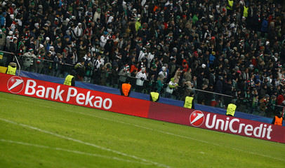 UniCredit and their Polish unit Bank Pekao logos are seen on the advertising banners during a Champions League match between Legia Warszawa and Sporting Portugal at Stadion Wojska Polskiego, Warsaw